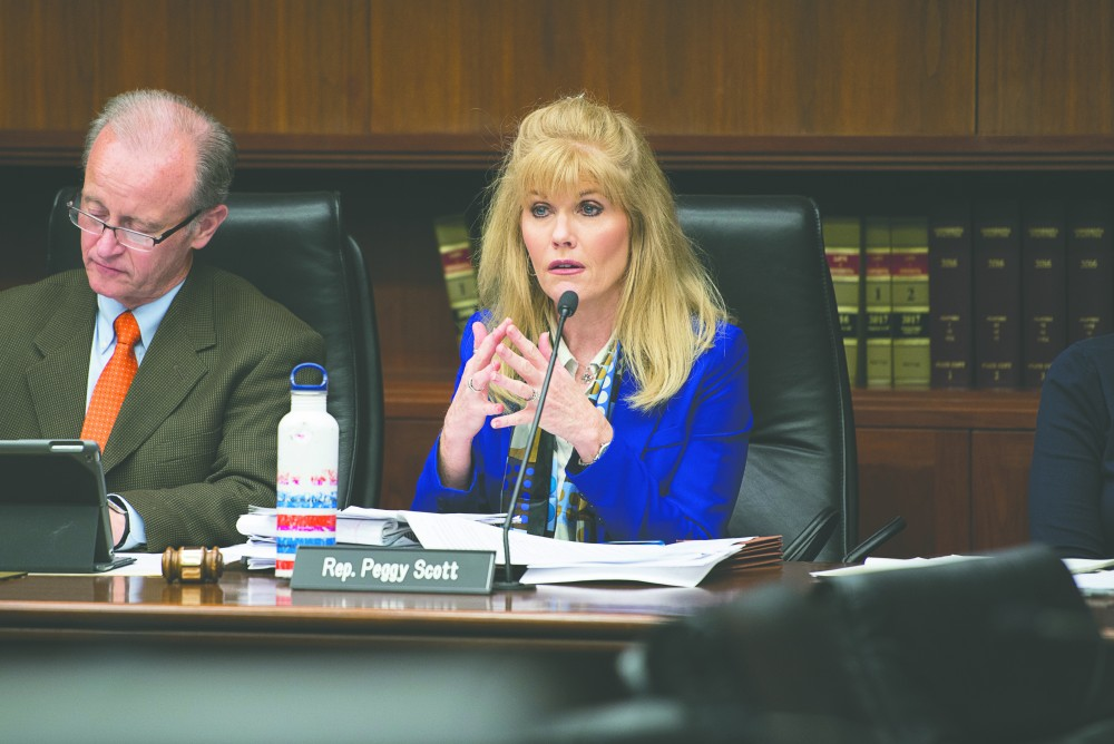 Rep. Peggy Scott, R-Andover, asks questions about the proposed bill on Tuesday, Oct. 17, at the State Office Building.