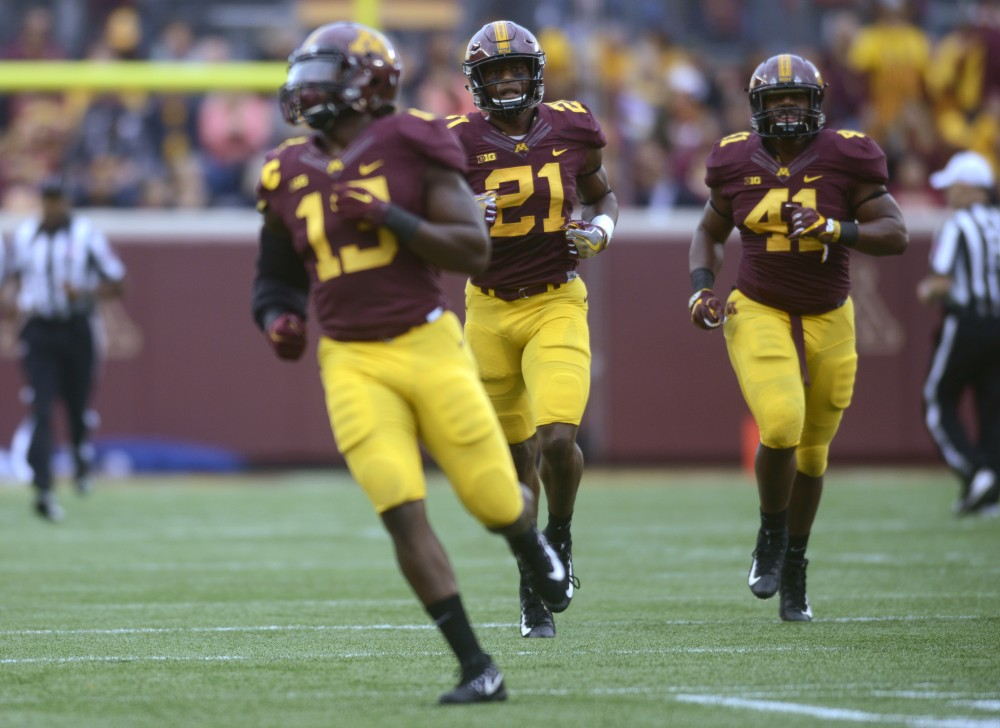Linebackers Jonathan Celestin, Kamal Martin and Thomas Barber run into formation on Saturday, Oct. 21 at TCF Bank Stadium. The Gophers defeated Illinois 24 to 17 during the Homecoming game.