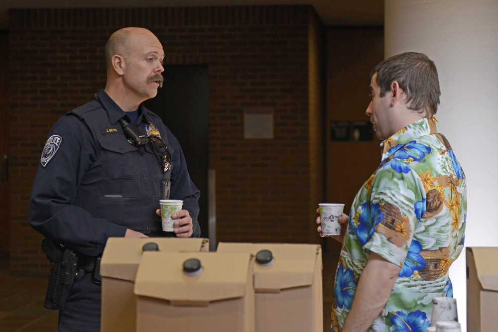 UMPD officer Josh Betts talks with student Franklin Rosenberg on Tuesday, Feb. 21 in Mondale Hall on West Bank.