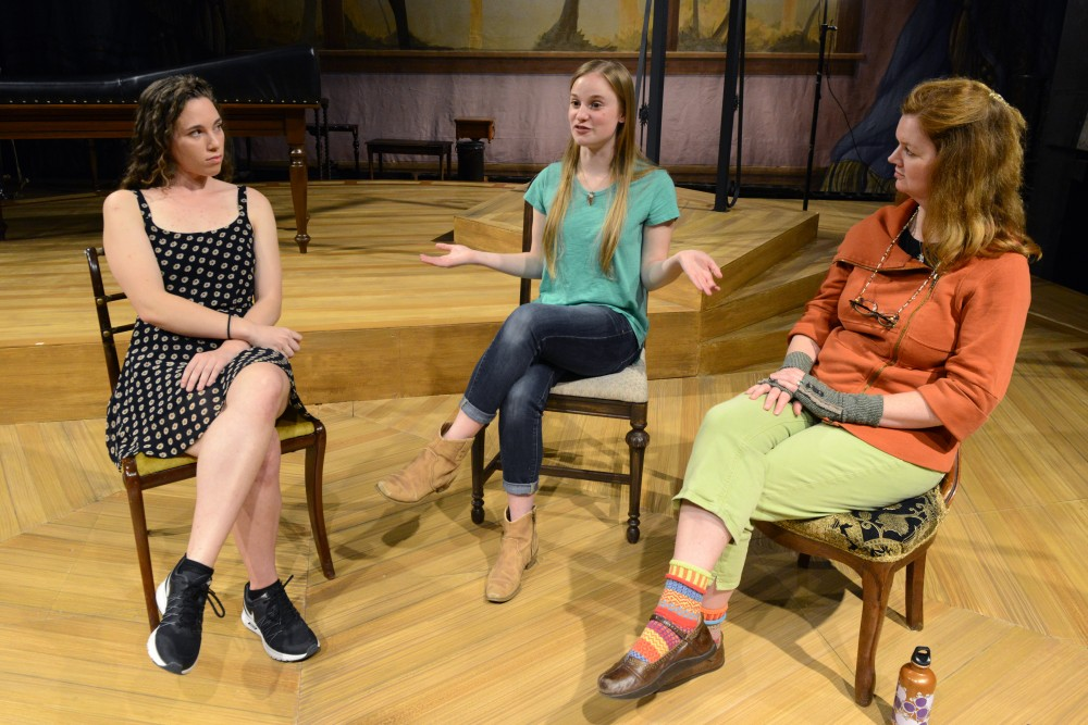 Isabel Enns, left, Tessa Dahlgren, middle, and Kate Powers, right, discuss their work in the play