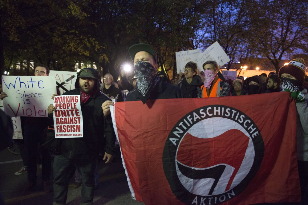 Members of the Anti-Fascist group speak out against right-wing commentator Lauren Southern outside of Anderson Hall on Wednesday, Oct. 25.