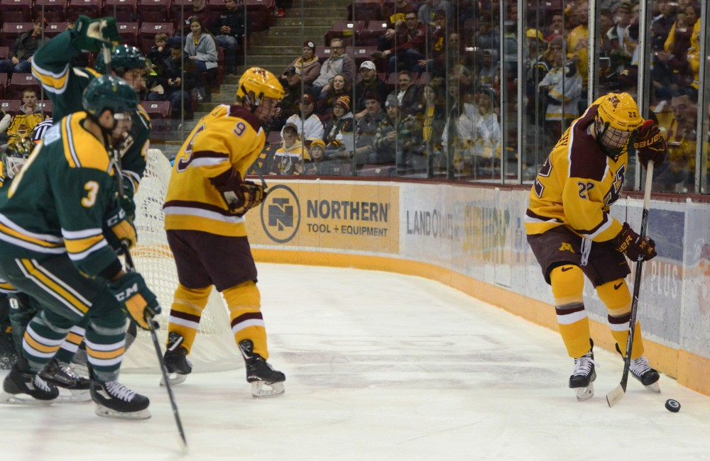 Junior forward Tyler Sheehy keeps the puck away from Clarkson on Saturday, Oct. 28 at 3M Arena at Mariucci in Minneapolis.