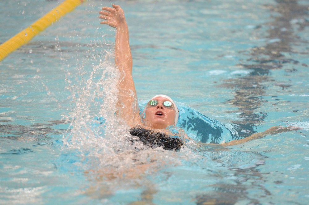 Sophomore Danielle Nack competes in the Women's 100 Yard Backstroke during the 2016 Minnesota Challenge at the Jean K. Freeman Aquatic Center on Saturday, Feb. 6, 2016.