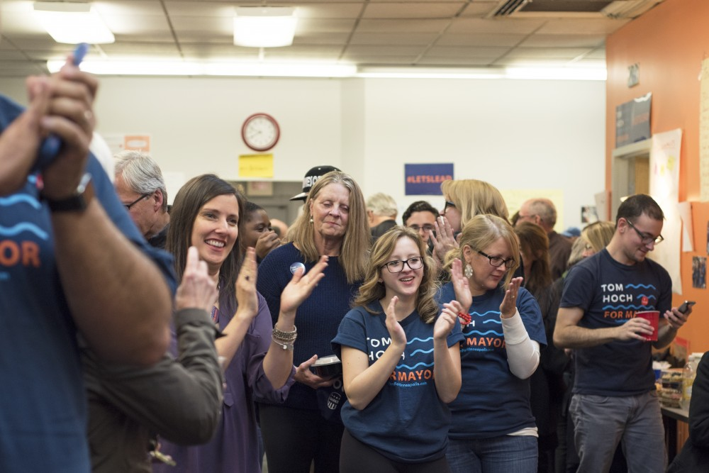 Tom Hoch's supporters applaud after hearing him speak during his election night party at his campaign office on Nov. 7.