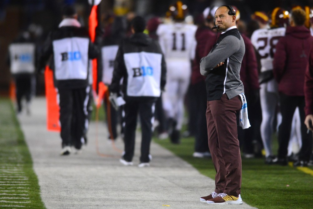Coach P.J. Fleck watches the big screen as a Michigan touchdown is confirmed on Saturday, Nov. 4, 2017 in Ann Arbor, Mich. The Gophers lost to the Wolverines 33-10.