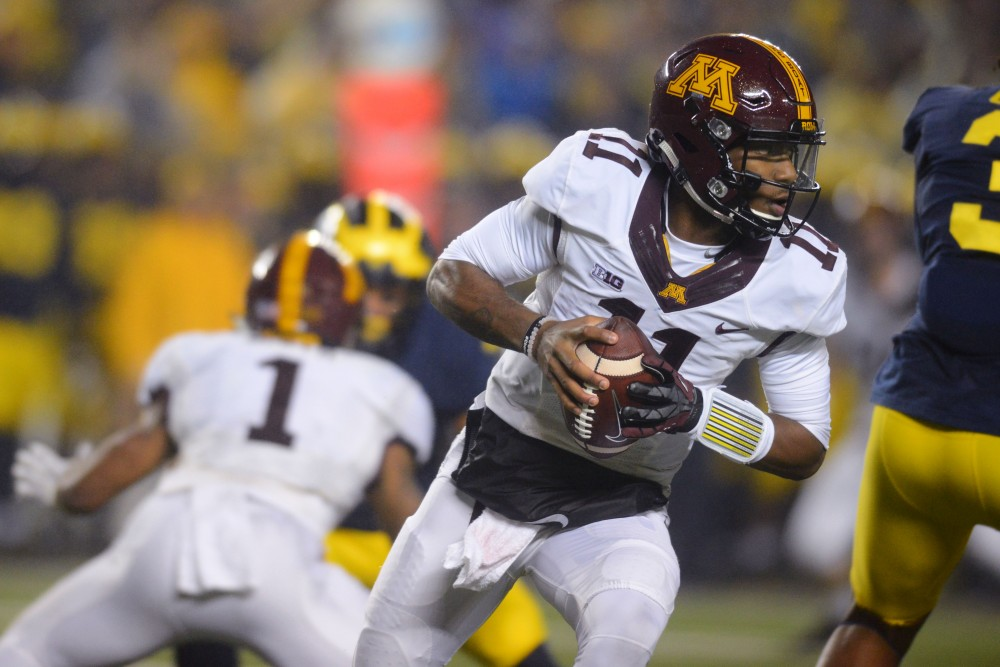 Quarterback Demry Croft looks for a teammate to pass to on Saturday, Nov. 4, 2017 in Ann Arbor, Mich. The Gophers lost to the Wolverines 33-10.