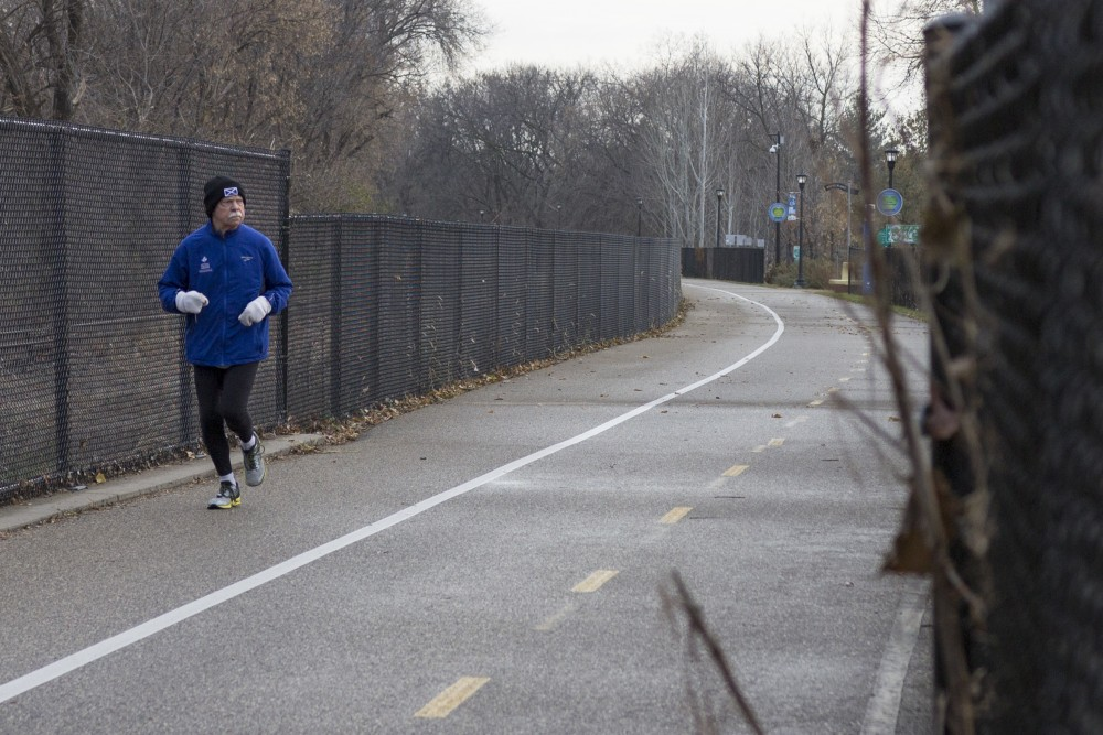 Bob Mac enjoys a quiet Saturday morning run on the current Midtown Greenway path on Saturday, Nov. 18.