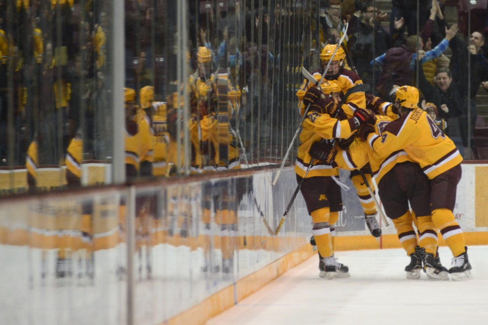 The Gophers Celebrate the game winning goal in overtime at 3M Arena at Mariucci on Saturday, Nov. 19. They beat Harvard 2-1 in overtime.