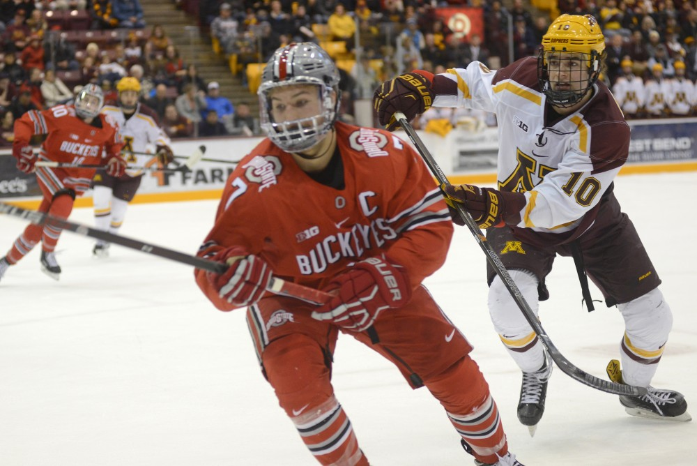 Gophers forward Brent Gates Jr. chases after the puck against Ohio State on Friday, Dec. 2, 2016 at Mariucci Arena.