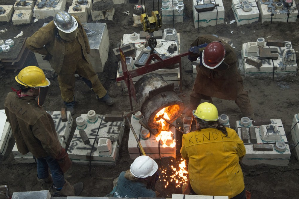 Participants engage in the University's Art Department's 31st annual Iron Pour at the Regis Foundry on Tuesday, Nov. 21.