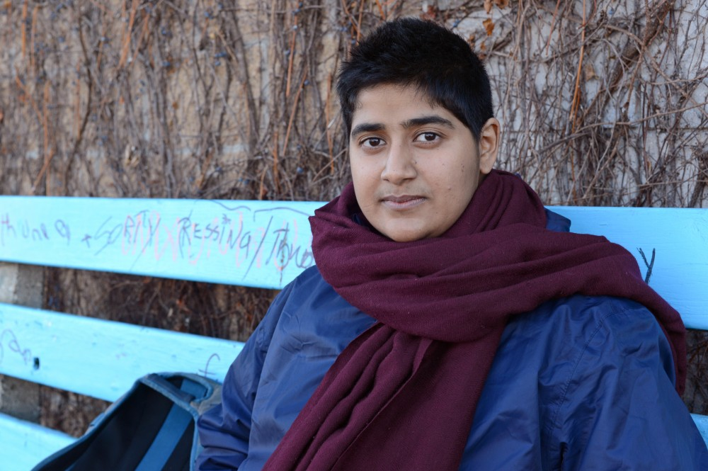 Ph.D. candidate in sociology Snigdha Rumar poses for a portrait at Seward Cafe on Saturday, Nov. 26.