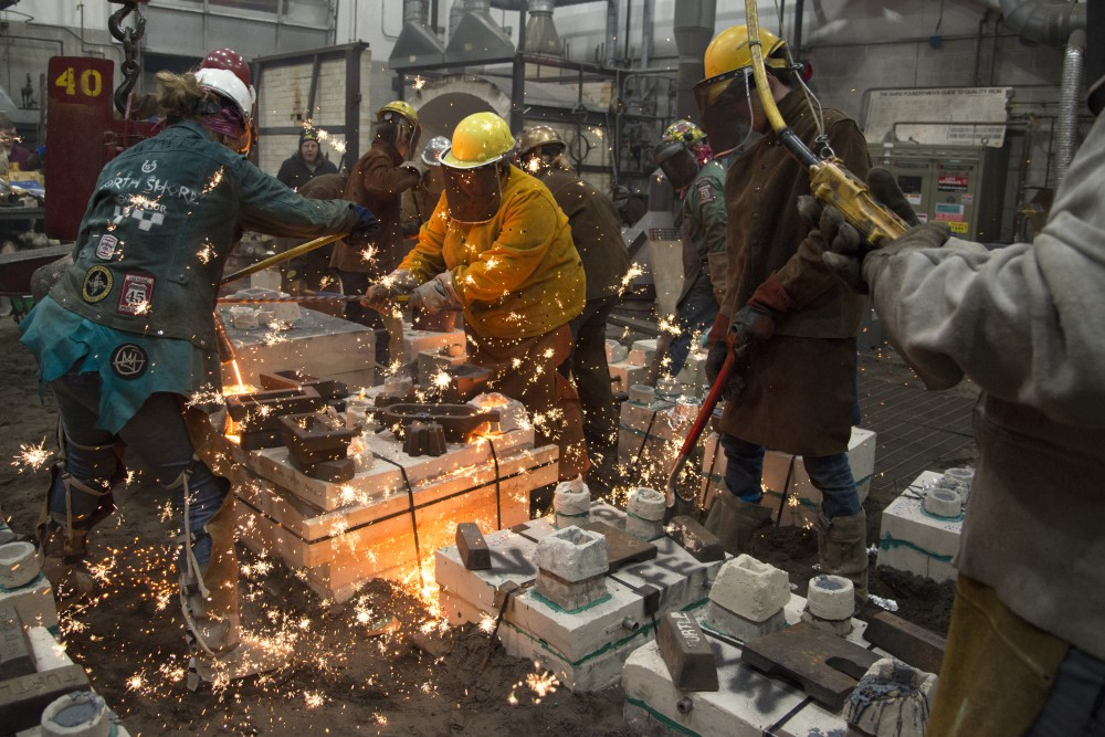 Participants engage in the Universitys Art Departments 31st annual Iron Pour at the Regis Foundry on Tuesday, Nov. 21.