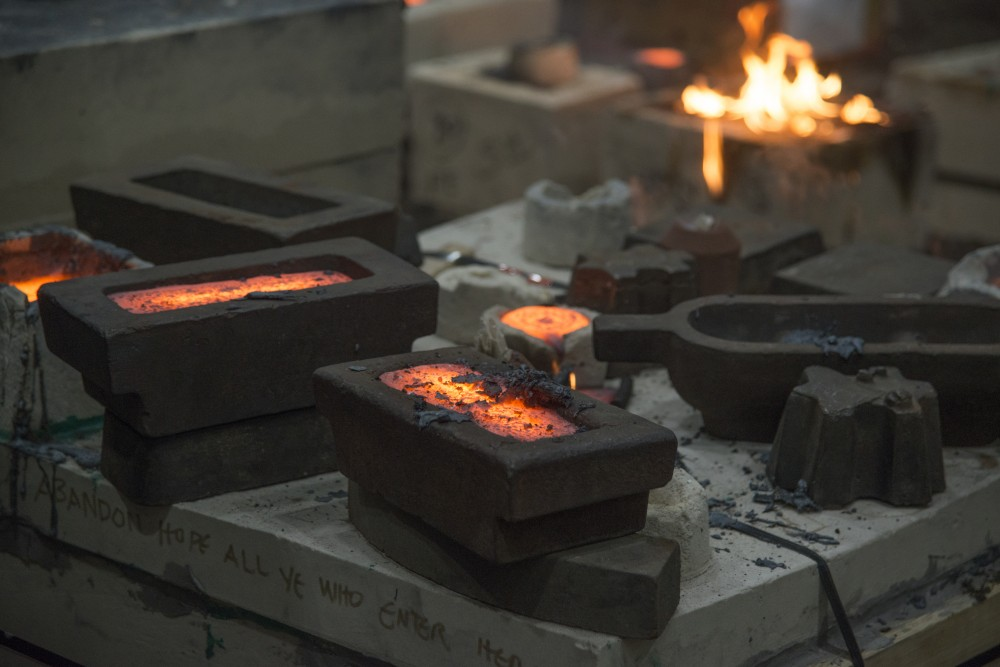 Molds recently filled with hot iron during the Universitys Art Departments 31st annual Iron Pour at the Regis Foundry on Tuesday, Nov. 21.