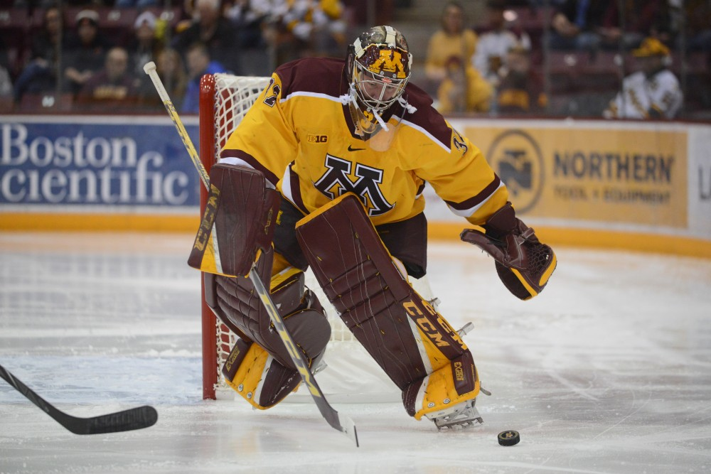 Goalie Eric Schierhorn eyes the puck at 3M Arena at Mariucci on Saturday Nov. 19.