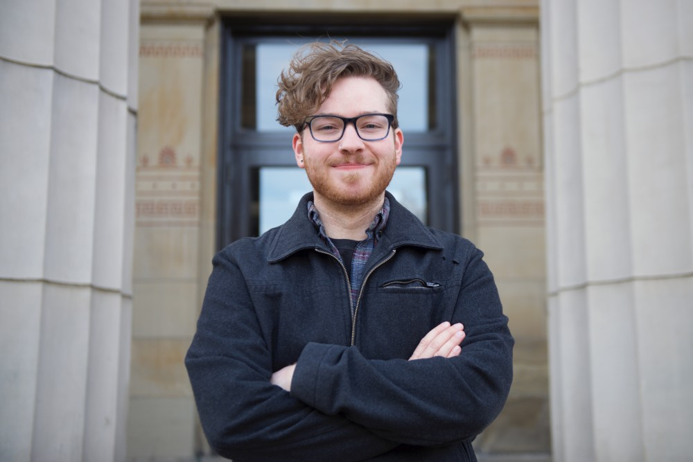 Troy Wildenberg poses for a photo on Wednesday, Nov. 29 outside of Burton Hall on East Bank.