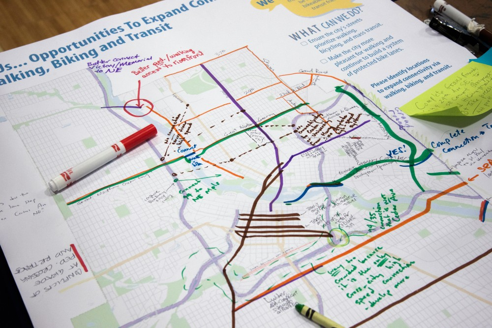 Members of the public add their comments about walking, biking and transportation to a large map during a Minneapolis 2040 community outreach event in Como on Saturday, Dec. 2. Suggestions included the completion of the Granary Corridor linking Dinkytown and Southeast Como.