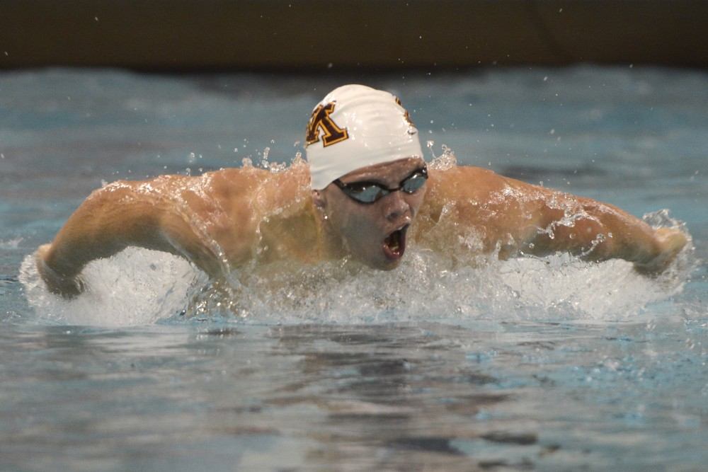 Sophomore Tuomos Pokkinen swims the 200 yard butterfly race during the Minnesota Invitational on Saturday, Dec. 2 at the Jean K Freeman Aquatic Center.