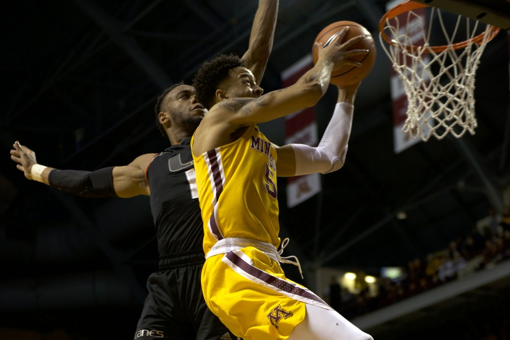Sophomore guard Amir Coffey goes up for a basket during a game against Miami on Nov. 29 at Williams Arena.