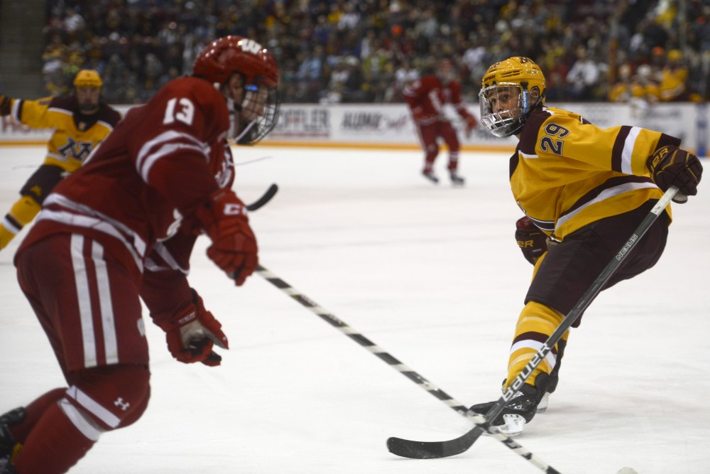 Sophomore defenseman Tyler Nanne blocks Wisconsin forward Ryan Wagner's path on Saturday, Dec. 2 at 3M Arena at Mariucci.
