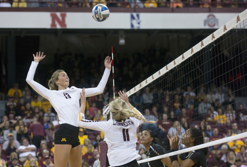 Middle blocker Molly Lohman jumps to spike the ball against Purdue on Wednesday, Oct. 11 at Maturi Pavilion.