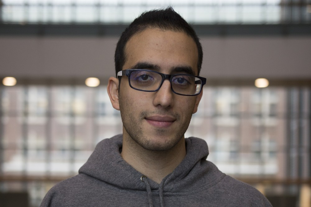 <p>Sina Shirinpour, a Ph.D. Candidate in the Department of Biomedical Engineering, poses for a portrait inside Nils Hasselmo Hall on Wednesday, Dec. 13. Originally from Tehran, Iran, his residence in the U.S. is affected by the Supreme Court's ruling of the new travel travel ban. </p>
