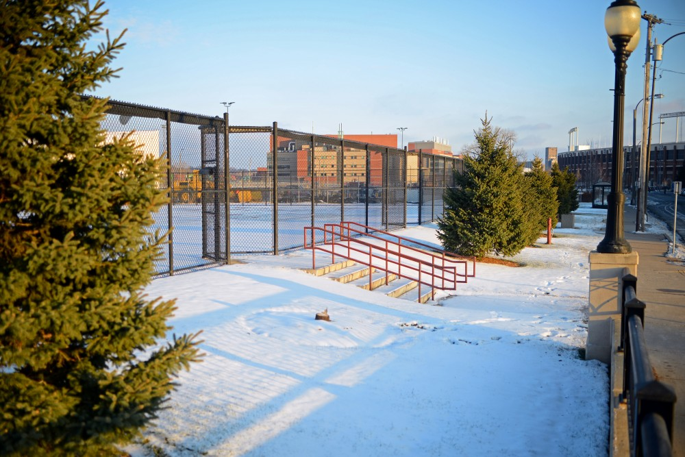 The remnants of a tree that was cut down and stolen along the tennis courts on 5th Avenue South East as seen on on Sunday, Dec. 10 near 3M Arena at Mariucci.