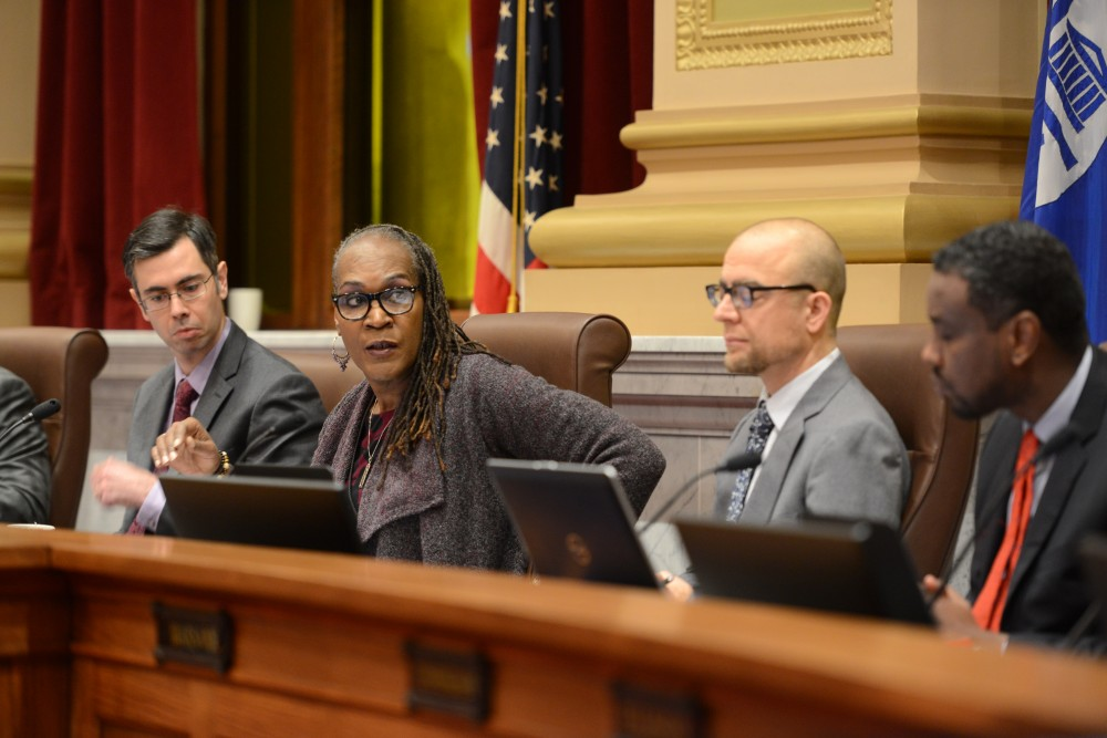 City Council Vice President Andrea Jenkins listens to City Council member Phillipe Cunningham during the morning meeting on Friday, Jan. 12, at Minneapolis City Hall.