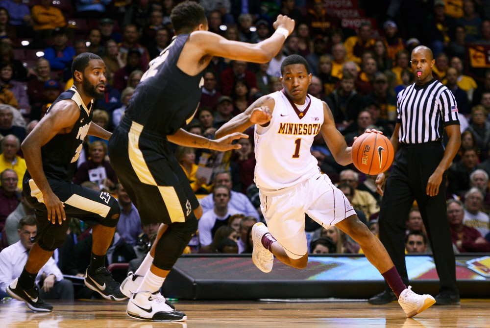 Junior guard Dupree McBrayer drives towards the basket during a game against Purdue at Williams Arena on Jan. 28, 2016.