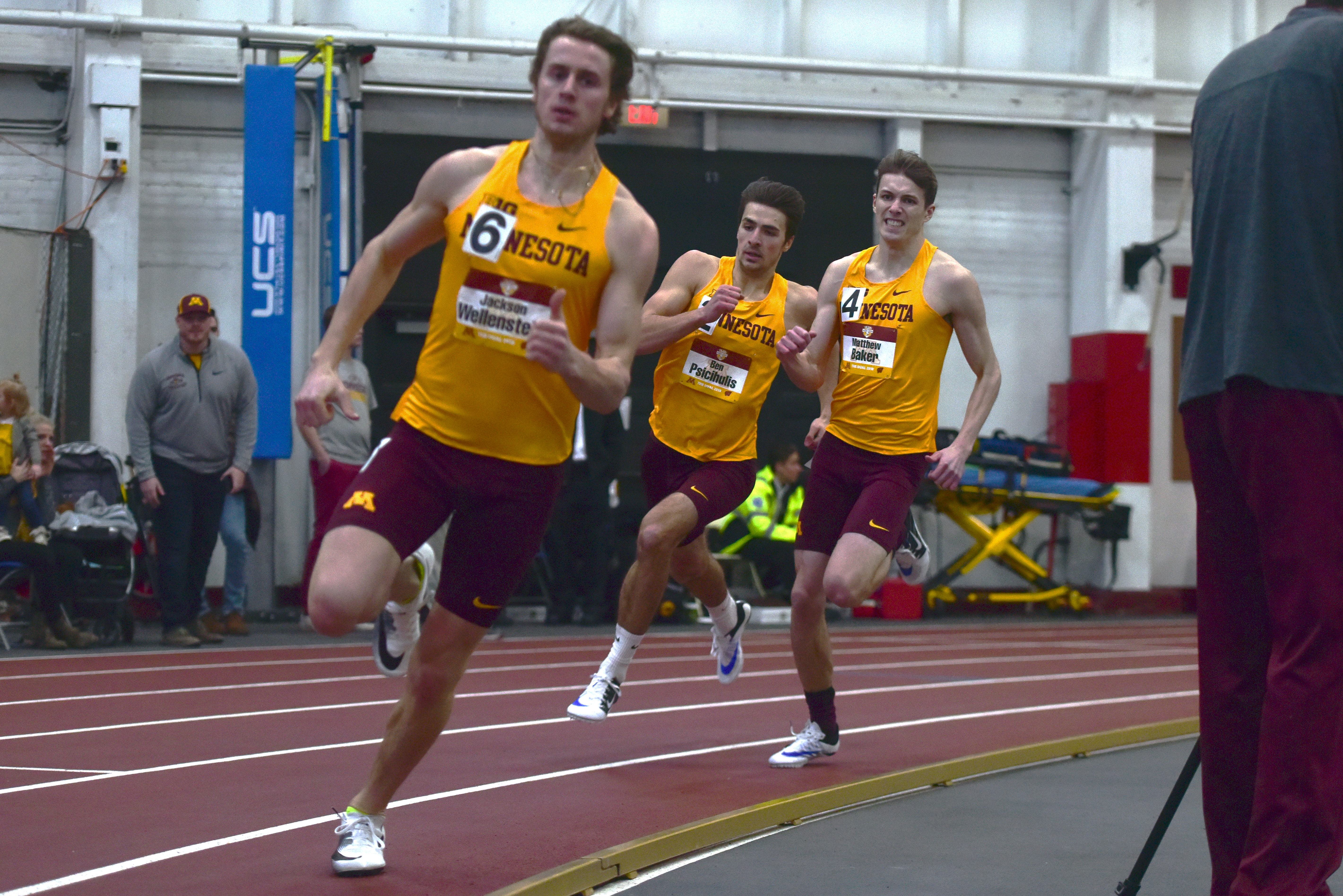 Gophers Jackson Wellenstein, Ben Psicihulis, and Matthew Baker compete in the 4x400-meter relay during the Border Battle on Saturday. The relay team finished 3:18.73, helping secure the Gopher's fourth-consecutive Border Battle title.