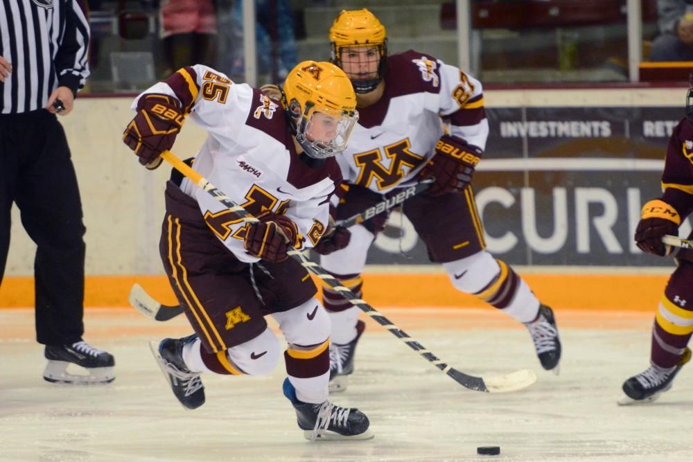 Redshirt junior forward Nicole Schammel skates with the puck on Friday Dec. 8 at Ridder Arena.