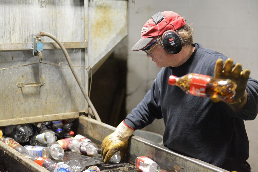 Utility worker Jeff Berry sorts plastic, aluminum and tin at the Como Recycling Facility in Minneapolis on Feb. 3, 2017.