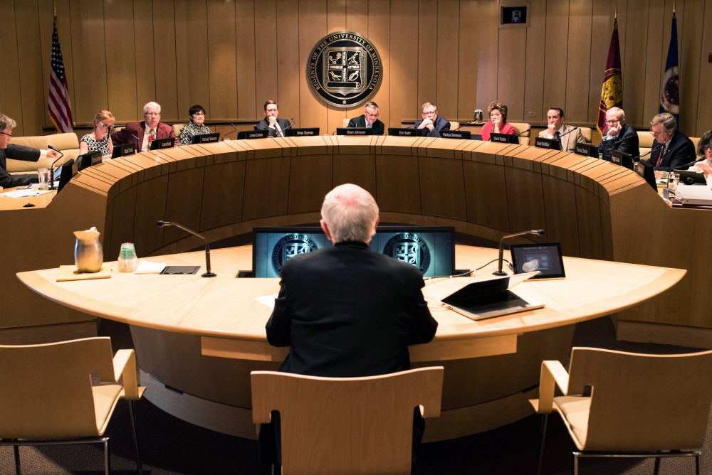 The University's Board of Regents talk at a meeting on June 10, 2016.