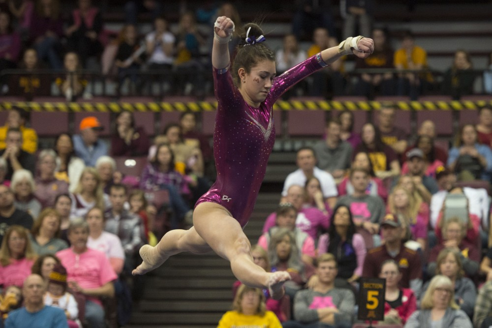 Ona Loper performs her floor routine at the Maturi Pavilion on Saturday, Jan. 20, 2018. The Gophers defeated the Michigan State Spartans 196.075 to 194.925.