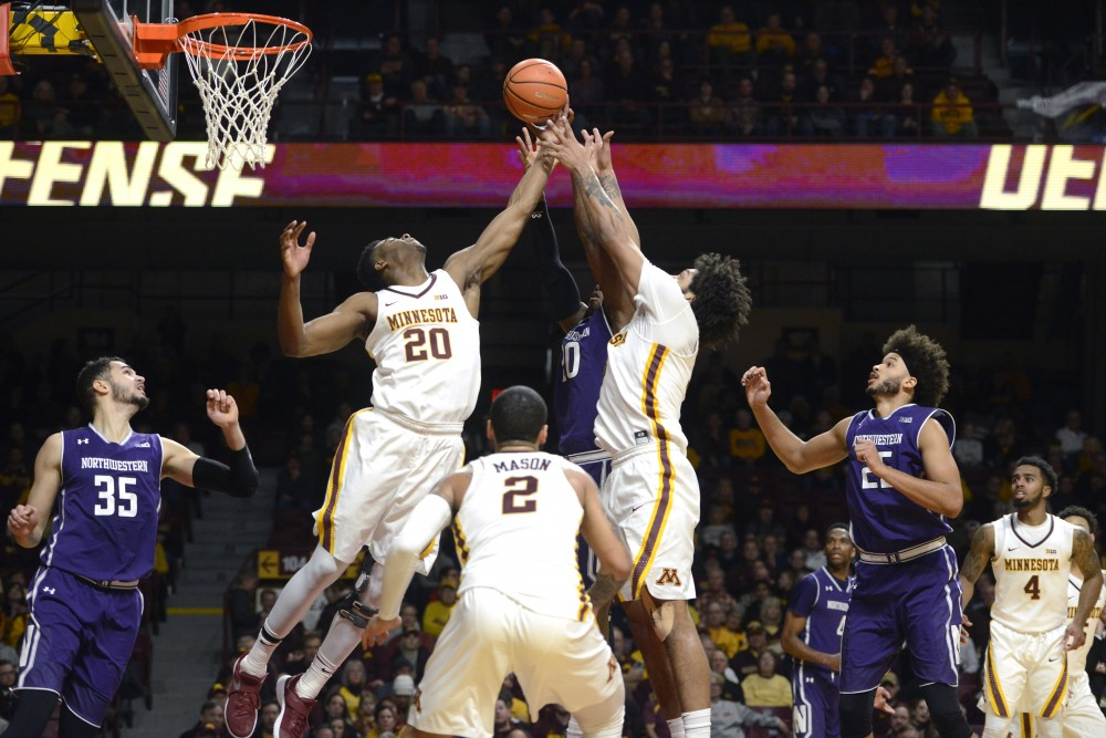 Forwards Davonte Fitzgerald and Jordan Murphy go up for the ball during a game against Northwestern at Williams Arena on Tuesday.