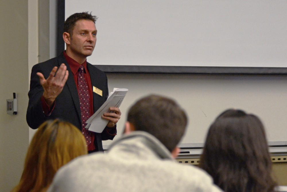 Jeff McKinley, resident district manager for the University's food supplier Aramark, fields questions from MSA representatives about the University's dining contract during forum in Frasier 102 on Tuesday, Jan. 23.
