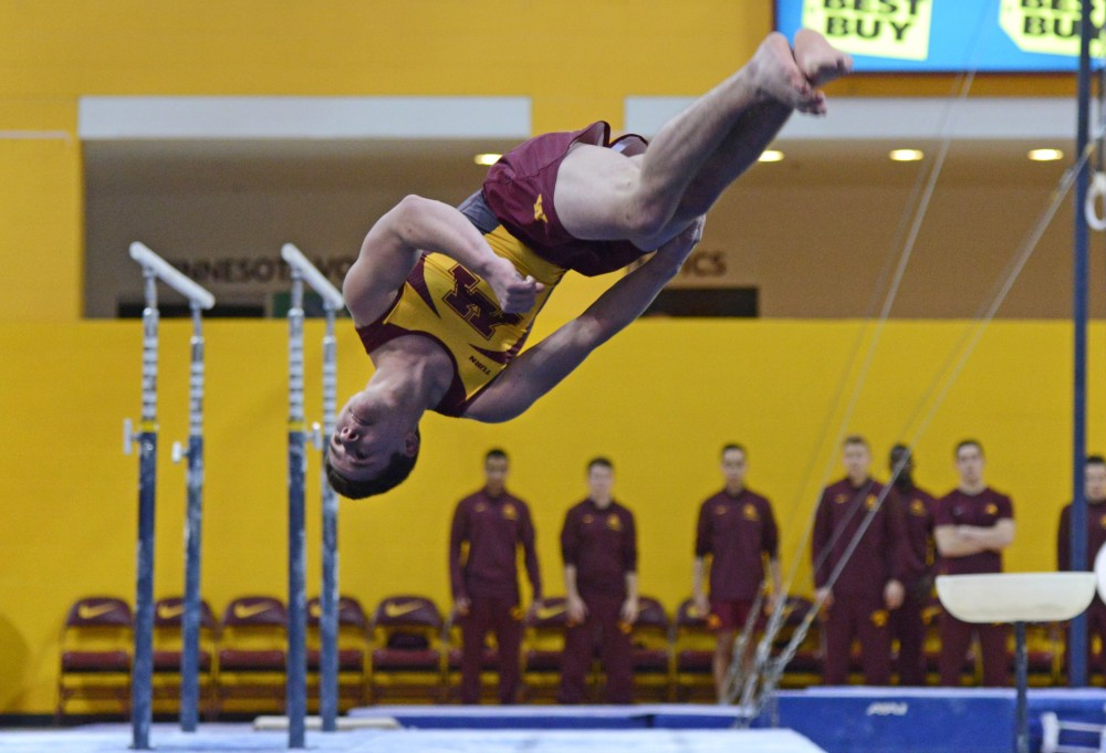Shaun Herzog competes on the high bar during the Gophers' meet against the Air Force on Jan. 21, 2017. The Gophers beat the Air Force 407.700 to 395.350.