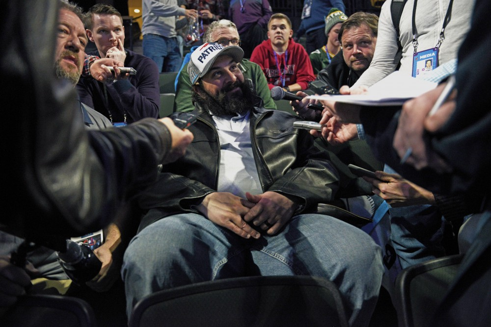 Defensive coordinator for the New England Patriots Matt Patricia sits down with reporters during the Super Bowl LII Opening Night event at the Xcel Energy Center on Monday.