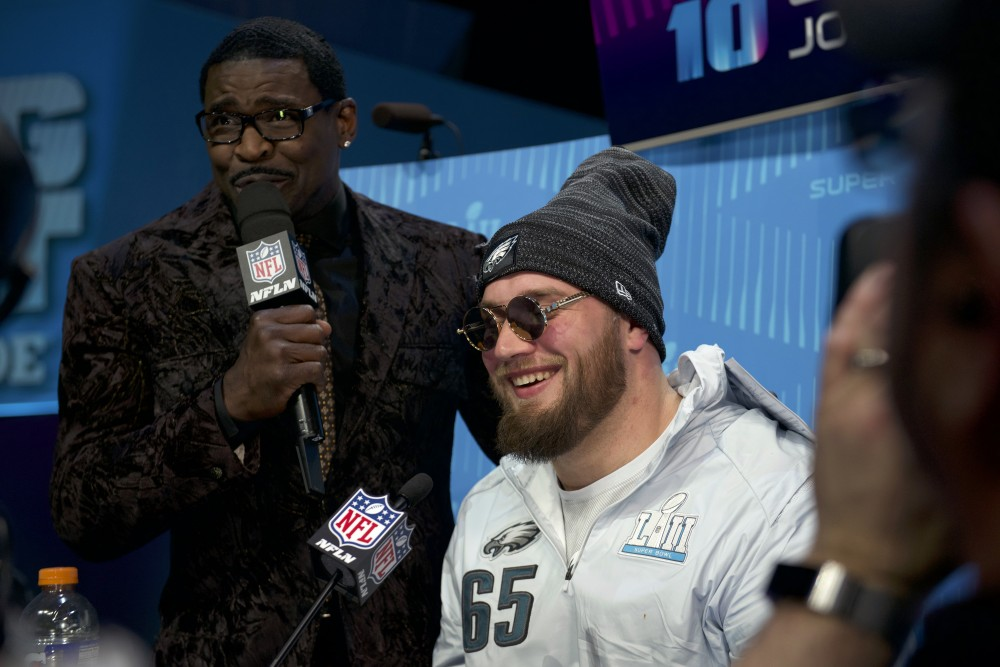 Retired football player Michael Irvin shares a few words with Philadelphia Eagles offensive tackle Lane Johnson for the NFL Network during the Super Bowl LII Opening Night event at the Xcel Energy Center on Monday.