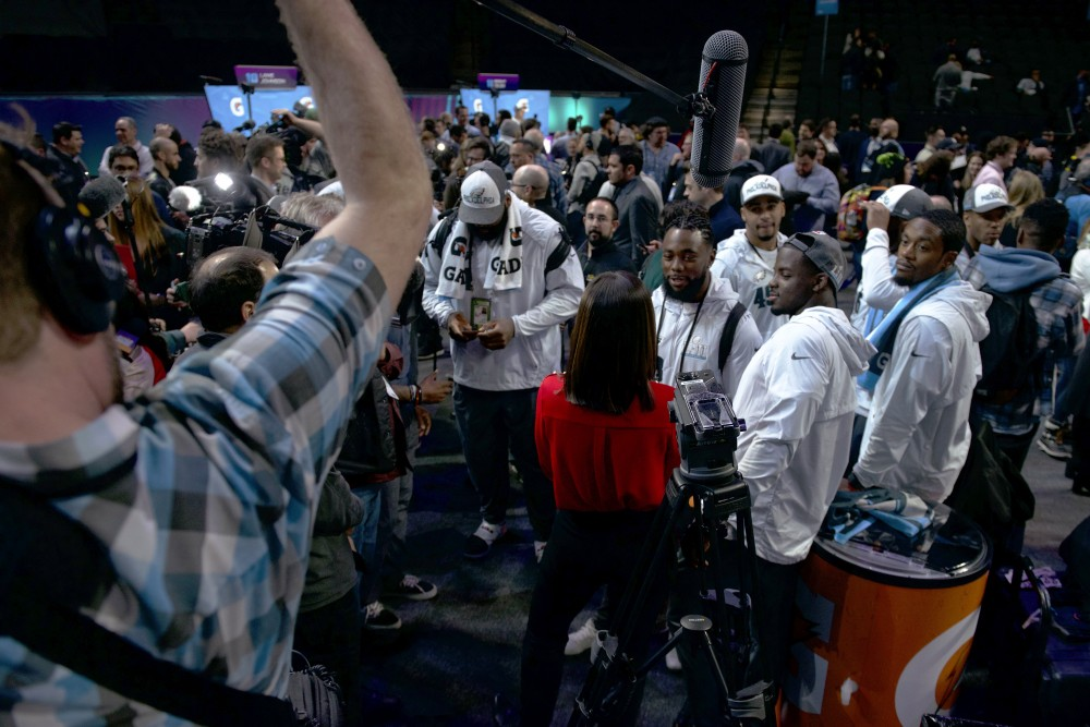 Philadelphia Eagles players meet with press on the floor of the Xcel Energy Center during the Super Bowl LII Opening Night event on Monday.