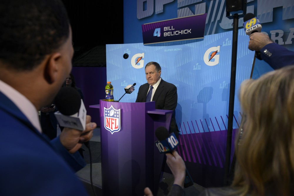 General Manager of the New England Patriots Bill Belichick speaks to members of the press during the Super Bowl LII Opening Night event at the Xcel Energy Center on Monday.