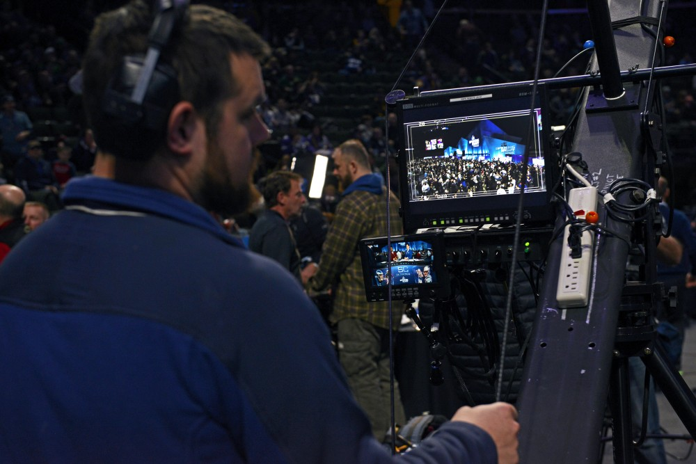 A camera operator controls a crane during the Super Bowl LII Opening Night event at the Xcel Energy Center on Monday.