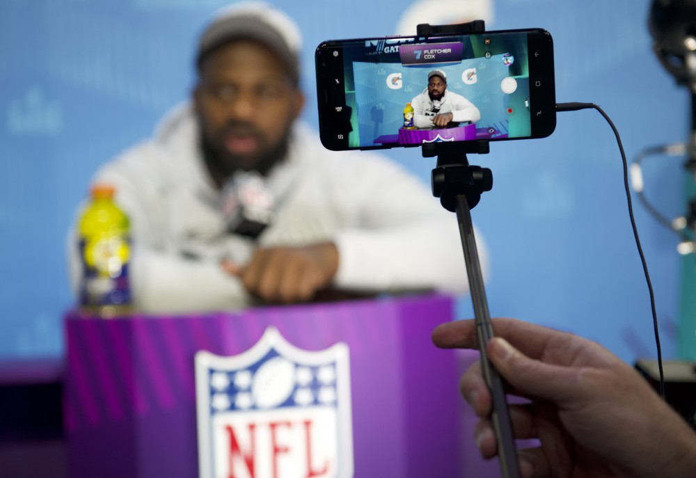 A reporter films Philadelphia Eagles defensive tackle Fletcher Cox with their smart phone during the Super Bowl LII Opening Night event at the Xcel Energy Center on Monday.