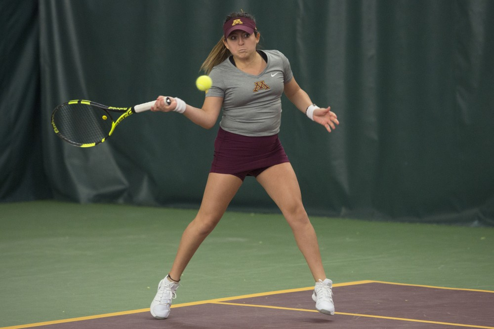 Junior Camila Vargas Gomez returns the ball during her singles match at the Baseline Tennis Center on Friday, Jan. 26.