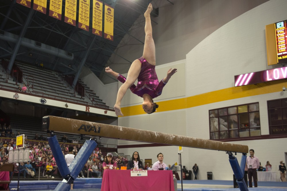 Sophomore Ivy Lu performs her beam routine at Maturi Pavilion on Saturday, Jan. 20. The Gophers defeated the Michigan State Spartans 196.075 to 194.925.
