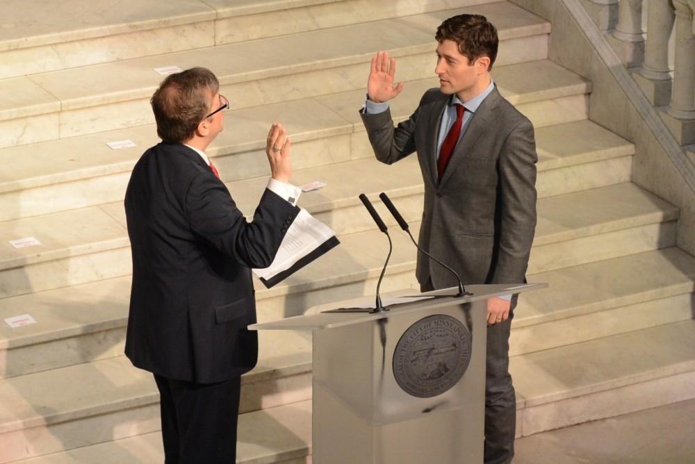 Mayor Jacob Frey is sworn in by City Clerk Casey Joe Carl during his inauguration inside the Minneapolis City Hall rotunda on Monday morning.