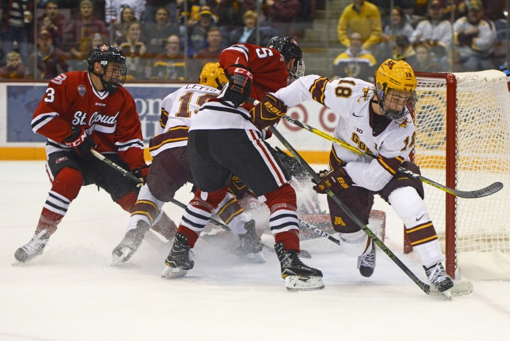 <p>Gophers forward Leon Bristedt assists forward Taylor Cammarata with his first period goal against St. Cloud State at 3M Arena at Mariucci on Oct. 21, 2016.</p>