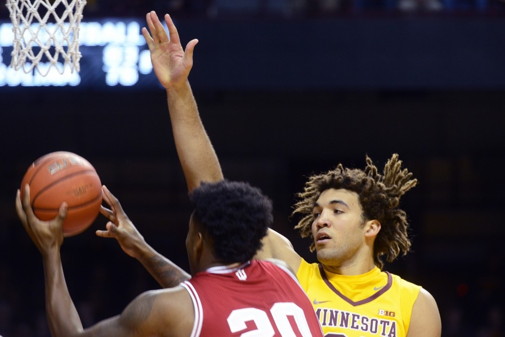 Gophers center Reggie Lynch reaches to block a shot against Indiana University on Wednesday, February 15, 2017 at Williams Arena.