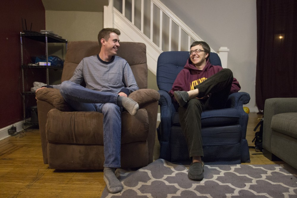 Max Boyle and Nick Hotz sit in their home on Tuesday, Jan. 30. They plan to stay with family and friends over the course of the Superbowl weekend as they rent out their house through Airbnb.