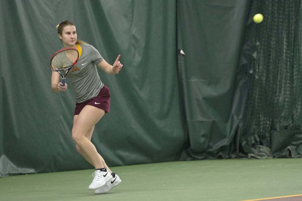 Senior Caroline Ryba prepares to return the ball to the University of Northern Iowa during her singles match at the Baseline Tennis Center on Friday, Jan. 26.
