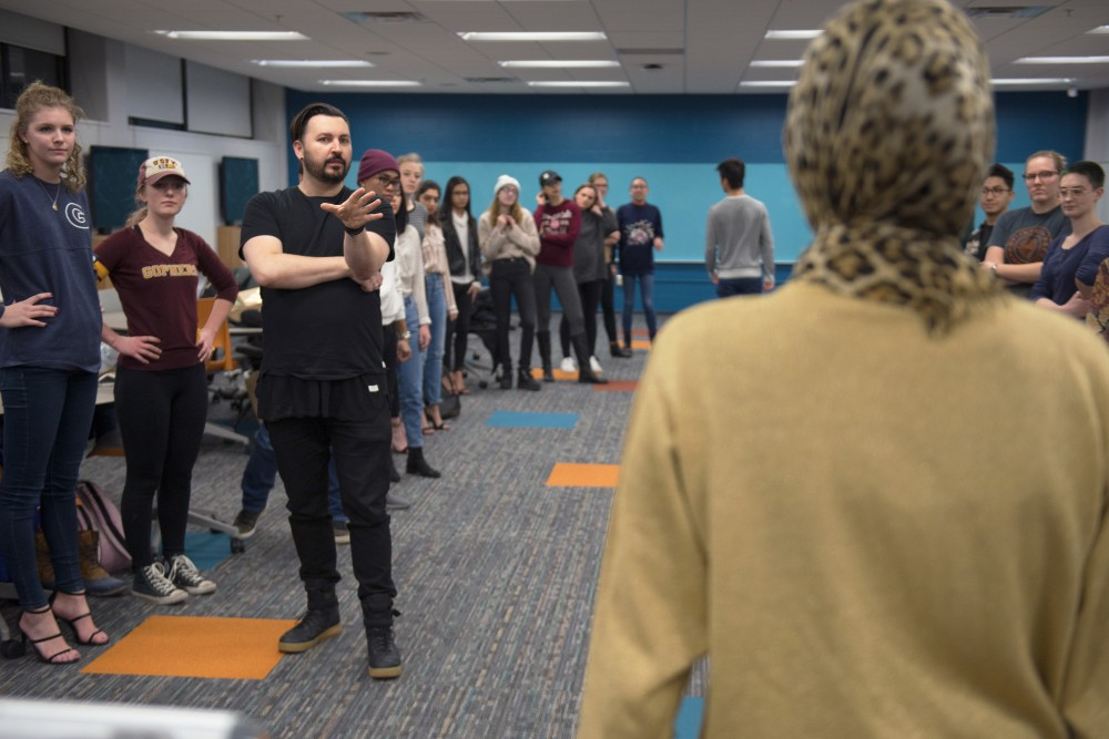 Dustin Dorris instructs students on how to walk the runway in Rapson Hall on Friday, Feb. 2.
